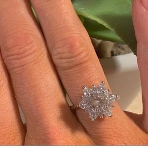 Glistening white sapphire floral ring